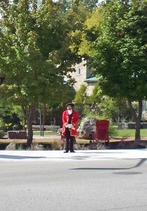 The town crier addresses visitors in front of Elora's Greenspace.